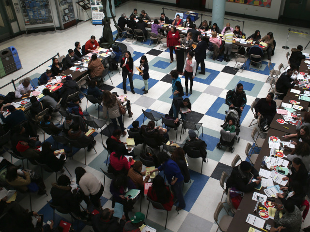 Volunteers Assist Immigrants With Citizenship Applications